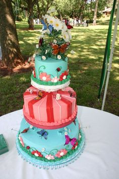 colorful wedding cake! Love butterflies and stripes