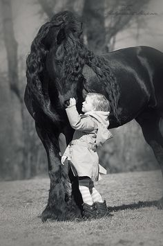 Fresian horse and child - Gosia Makosa photography Please o please this is how I want my kid to grow up.