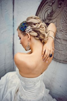 Gorgeous peacock feather adorned hair style. So gorgeous!