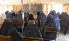 Afghan student women attend a maths class under a tent at the Nangarhar University campus in Jalalabad.  Photograph: Noorullah Shirzada/AFP/Getty Images