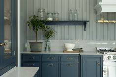 Lovely color ocean blue hand painted on ash for the perfect feel and finish. Shaker Kitchen, Kitchen Redo, New Kitchen, Kitchen Remodel, Kitchen Dining, 2 Colour Kitchen Cabinets, Painting Kitchen Cabinets, Blue Cabinets, Beach House Kitchens