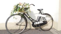 Vintage Bike with flower basket and signage.Wedding decor.