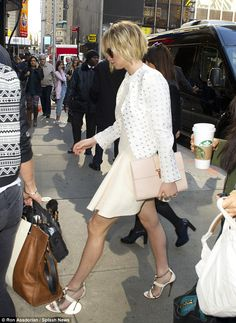 Walking: She turned the streets of Manhattan into a runway... http://dailym.ai/1jrqy3J#i-aab10e7c
