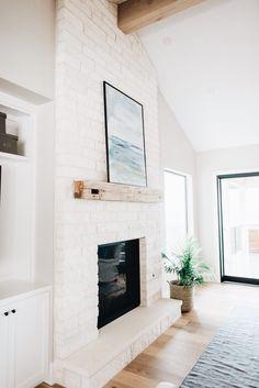 Cozy Fireplace | Modern Spanish Bungalow #turquoiseandtobacco #apartmenttherapy #blancobungalow #mydomaine #interiordesign #spanishrevival #dominomag #whitedecor #whiteinterior