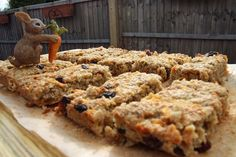Carrot Cake flavours in a breakfast bar. Carrot and Raisin Flapjacks Ingredients Makes about 10 - 12 120g butter 4 tablespoons runny honey 75g golden caster sugar 240g rolled oats 1 large carrot, grated (or two medium) Handful of raisins A good pinch of cinnamon, ginger, nutmeg Method Preheat oven to gas mark 6. Line a baking tray with greaseproof paper. My tray measured 7 ½ inch by 11 inch. In a large saucepan, melt the butter, honey and sugar until it all melts. Take of the heat, then…
