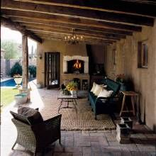 Mediterranean Style Home: The loggia is furnished as an outdoor living area, complete with a raised cooking fireplace.