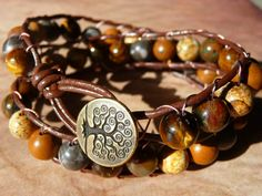 Boho style ladder bracelet with beautiful earthy coloured semi precious stones and an antique copper tree of life clasp button. Great for wearing on nature walks, camping or a walk in the park.