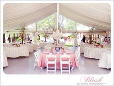 Tent wedding with soft colors and a blush pink on the tuscany headtable.