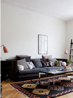 Love the depth of color in the sofa paired with a slightly more colorful rug.