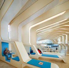 A library in Norway.. Norveç'te bir kütüphane. Biz daha hala defekasyonumuzdan tenya ayıklıyoruz!