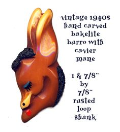 Very Scarce Large Vintage Carved Painted Bakelite Burro Head with Black Caviar Bead Mane ~ R C Larner Buttons at eBay  http://stores.ebay.com/RC-LARNER-BUTTONS
