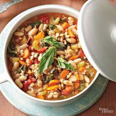 This is one of our most popular soups at Better Homes and Gardens! The flavorful vegetarian soup has just 4 grams of fat because it relies on garlic, fire-roasted tomatoes, lemon juice, and a bit of feta cheese to add flavor to the grains and vegetables.  /