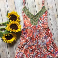 "⚡️ SALE⚡️2x HPFree People Beaded Sunflower Dress Great for summer! 100% cotton! Adjustable shoulder straps and drawstring waist which ties in back. Beautiful beaded bib with glass and wood beads. The length with the straps at their shortest is 33"". The waist with the drawstring fully extended is 16"" flat. Absolutely adorable! HP 5/23 and 6/8  Free People Dresses"