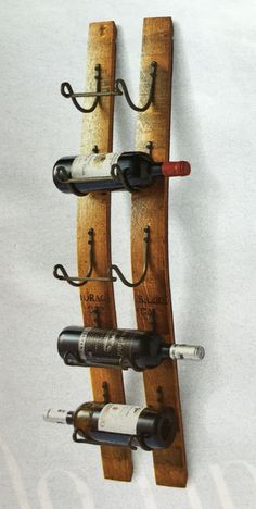 Reclaimed Wine Stave Wine Rack by Frontgate I will use old skis. Industrial Wine Racks, Wood Wine Racks, Wine Rack Wall, Wine Bottle Glass Holder, Wine Barrel Furniture, Barrel Projects, Pallet Wine, Wine Cellar Design, Wine Display