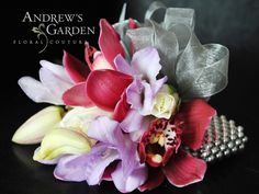 Corsage by Andrew's Garden.