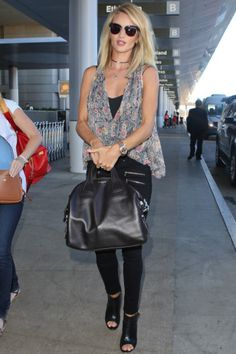 Rosie Huntington-Whiteley wearing Gianvito Rossi peep-toe booties at LAX airport.