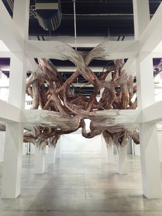 EXISITENCE - Henrique Oliveira Palais de Tokyo. Calmness of the building is a clash with the twisted wood sculpture.