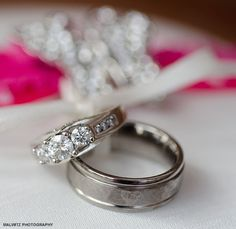 Three round diamonds for her and a textured band for him