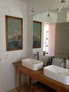 antique pine table vanity, glass light fixtures, sail boat picture hiding medicine cabinet