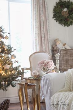 FRENCH COUNTRY COTTAGE: Decking the halls ~Holiday Housewalk Home Tour The tree in the living room is covered in warm white lights and silver, gold and whites.