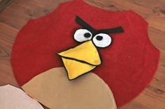 Angry Bird Costumes- This looks very simple, but could just use a large red sweat shirt and cut off the arms, add details, maybe stuff it.....