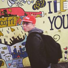 This picture is so candid with bright colors and some cool graffiti.I love it!