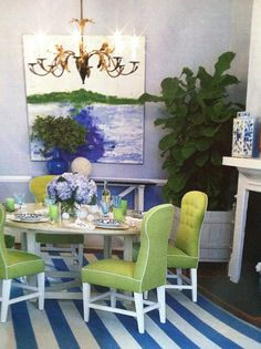 Design by Lynn Morgan in Savannah. Love the blue and green, contemporary art, fabulous green tufted chairs, awning stripe rub...everything! House Beautiful, April 2012.