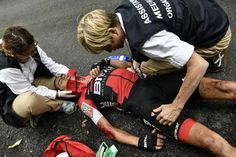 Richie Porte is attended by medical staff after crashing during stage 9 at the Tour de France