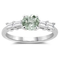 Green Amethyst Engagement Ring - This adorable Green Amethyst Engagement Ring showcases excellent quality! The Green Amethyst is accentuated with four baguette-cut Diamonds prong set in 14K White Gold & the Approximate Diamond Weight is equal to 0.32 Carats. The Approximate Gemstone Weight is equal to 0.85 Carats & is 100% natural & not heat treated. #unusualengagementrings