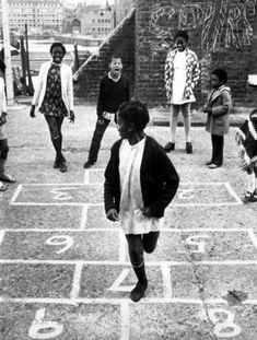 'Children playing hopscotch at a community centre run by the Make Children Happy charity near St Katherine's Dock, East London, 23 November – Getty Images Asian History, British History, Black History, Tudor History, Saint Katherine, Caribbean Carnival, African Children, Art Children, Historical Women