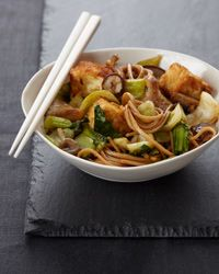 Crispy Tofu with Noodles. Chef Way Pino Maffeo deep-fries tofu in tempura batter, then garnishes the finished dish with lily buds. Easy Way Bread the tofu with panko (Japanese bread crumbs) and stir-fry in a wok. Skip the lily bud garnish.
