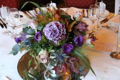 The low designs were in our lovely silver plated fruit bowls filled with fresh Hydrangeas, Roses, Lissianthus, Autumn Leaves, Berries, Freesia, Thistles and Champagne Grass in shades of Cadbury Purple, deep aubergine and Autumnal coppery browms