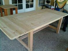 DIY Furniture Plan from Ana-White.com</a made of yellow pine and timber for the legs. The top is three 2X12 and the ends and removable extensions are 2X6. The legs are 4X4 timber. The table is extremely heavy