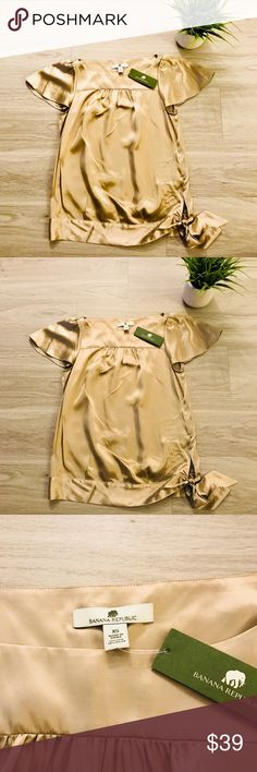 """Banana Republic Short Sleeve Silk Top Very cute Banana Republic Silk Top, looks great paired with Denim jeans and heels. This item is new with tags. Boat neckline, short sleeve, tan color.   Measurements: 28"""" chest, 25"""" Length Banana Republic Tops Blouses"""