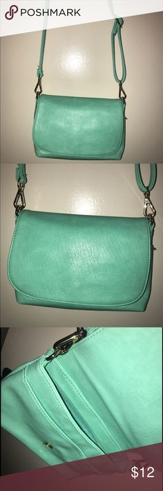 Teal cross body purse Cross body purse in teal. Gorgeous bright color! Only used a few times Bags Crossbody Bags