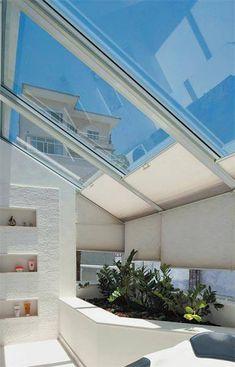 telhado/cobertura em vidro com proteção para o sol