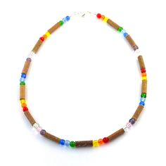 Hazelwood Rainbow Necklace! Effective in reducing acid-based ailments and symptoms, such as eczema, acid-reflux, and teething pain. Must be placed directly on the skin and worn 24/7. Made with nylon-coated steel wire, pressed glass beads, and silver plated nickel clasp (lobster style opening). Construction includes a safety release. Children under the age of three shouldn't wear a necklace without adult supervision. Product may be worn around the leg during naps and night.