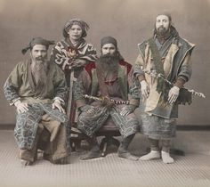 Portrait of three Ainu men and a woman - from the island of Hokkaido in northern Japan.  About 1900, Japan.    MIA.