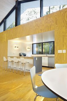 The Stack House is like a child's stack of blocks.   Real Good Counter Stools in Ivory by Blu Dot.