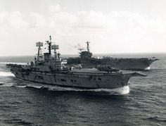 The first angled flight deck carrier, HMS Ark Royal, operating with the first super-carrier, USS Forrestal - 1972. Though ordered by their respective navies almost a decade apart, both were commissioned in 1955.