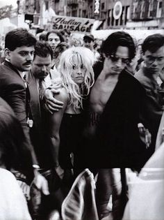 Pamela Anderson & Tommy Lee, 1995. I love this photo. I love how it captures Pamela's vulnerability