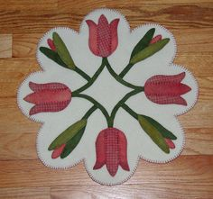 Spring Tulips Wool Applique Table Mat Penny by ecoughlindesigns Penny Rug Patterns, Wool Applique Patterns, Felt Applique, Quilt Patterns, Penny Rugs, Felted Wool Crafts, Felt Crafts, Felt Pillow, Felt Christmas Decorations