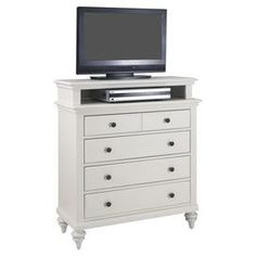 """4-drawer dresser with an open top shelf and turned feet.    Product: DresserConstruction Material: Mahogany and albazia veneersColor: Brushed whiteFeatures:  Four drawersTop drawer lined in black feltAntiqued hardware Dimensions: 42"""" H x 36"""" W x 16"""" D"""