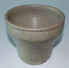 Hans Adolph Hjorth (1878-1966) produced the factory's first stoneware in 1902 for which he received several international awards. The children of Lauritz Hjorth took over the company following their father's death in 1912.  The vase is signed by the artist.