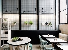 Wire mesh screen & fluorescent lights. Patch Studio 9 cafe by Studio You Me