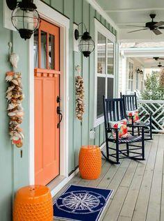 Orange door with window in shaker style.