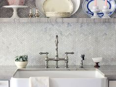 Mini marble herringbone backsplash with a lot of texture.