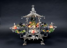 A  handsome centerpiece for Charlotte's dining table. Silver chinoiserie epergne Thomas Pitts, 1759.