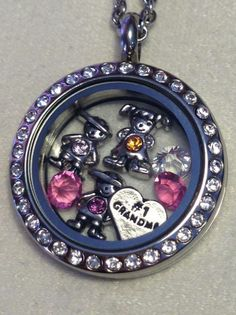 we have cute boy and girl charms with birthstones. Create a special keepsake for your #1 Grandma. See our great selection of lockets and charms at www.southhilldesigns.com/holdthevision or email dkruks@hotmail.com