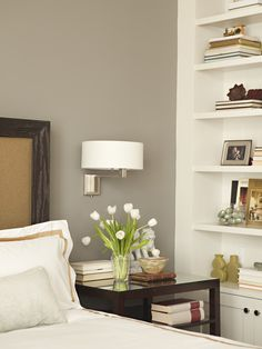 Sophisticated bedroom with warm gray walls paint color, chocolate wood ...